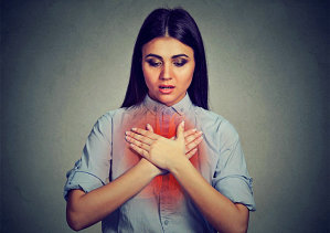 woman having a chest pain