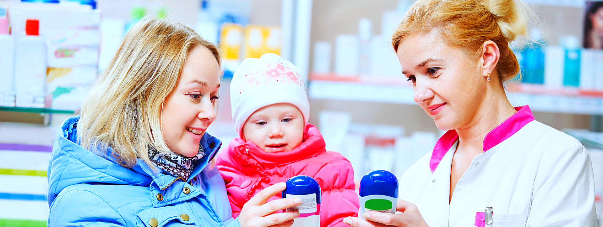 pharmacist assisting a woman carrying a baby